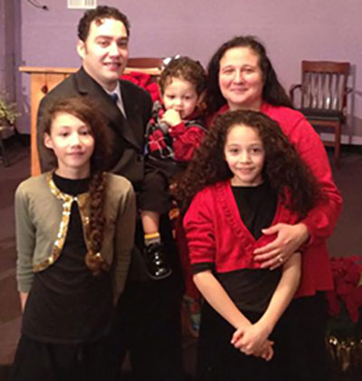 Reverend Antonio J. Velez Jr. and his family